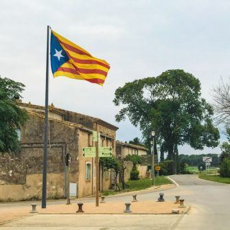 Small village with large Catalan flag flying