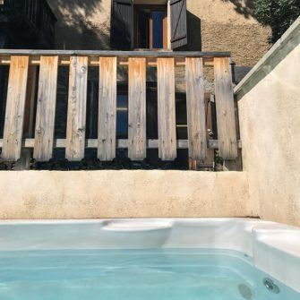 Swimming pool and outside decking at Chalet Ribot