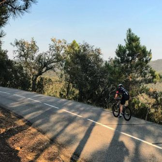 Cyclist on the els àngels climb near Girona