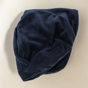 Headrest pillow folded down into a small square