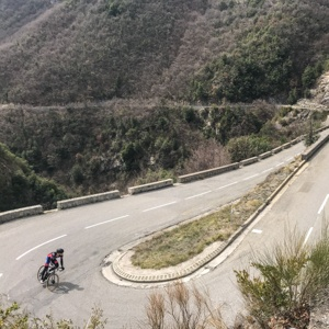 Hairpins on the Col de Turini with lone cyclist