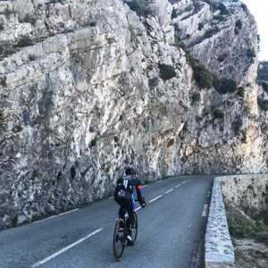 The road to Peille with a sheer rock cliff on the lefthand side