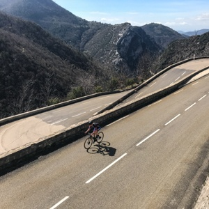 Impressive lacets of the Col de Braus with cyclist