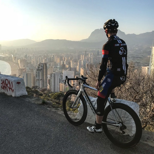 View from the top of the Serra Gelada with road cyclist in foreground