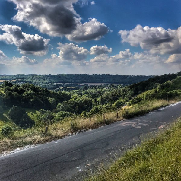Views back across the valley, halfway up Box Hill by bike