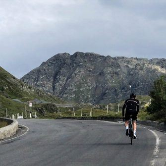Cyclist in the Italian Mountains in a vintage merino cycling jersey by Jura Cycle Clothing