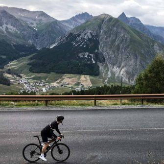 Cyclist in Italian mountains in retro bike jersey by Jura Cycling Clothing