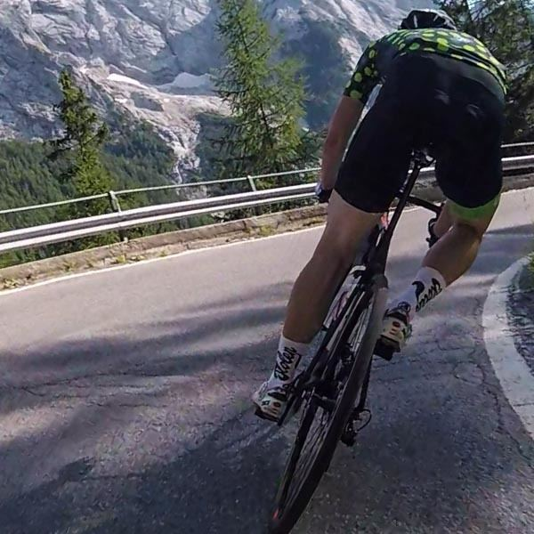 Cyclist descending in Stolen Goat bib shorts