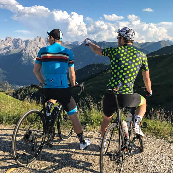 Two men in Stolen Goat jerseys looking at the view