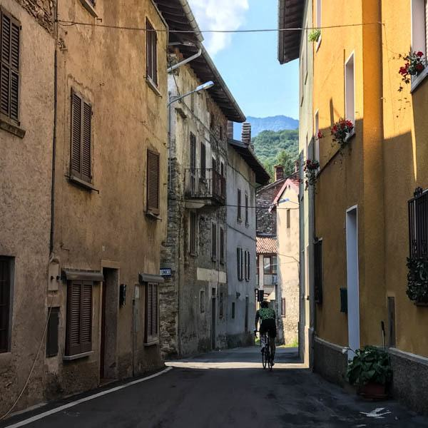 Cycling through the narrow streets of Rogiano Valtravaglia on the UCI Gran Fondo World Championships road roace coures 2018 Varese