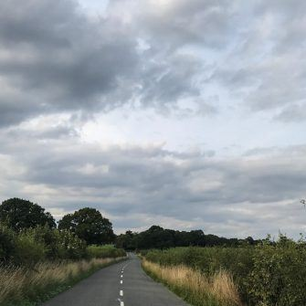 Country lane with big sky on Velo south ride