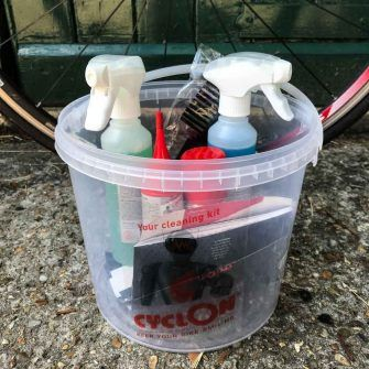 Cycling bike care cleaning kit in tub on ground