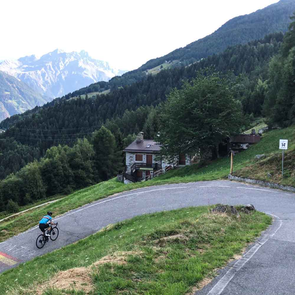 Cyclist on switchback on Passo Mortirolo