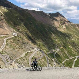 View of the Stelvio from the summit, with cyclist