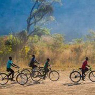Buffalo bikes ridden by children in Africa