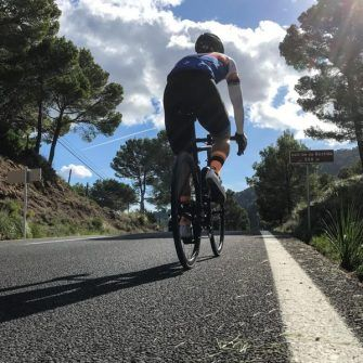 Cyclist cycling hilly coast road in Mallorca