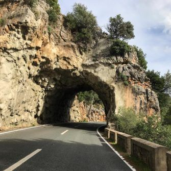 Rock tunnel on the MA-10 climbing Puig Major by bike, Mallorca