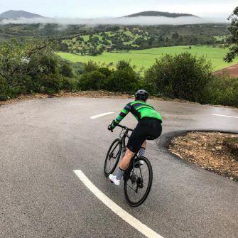 Cyclist descending around corner on Mallorca 312 route