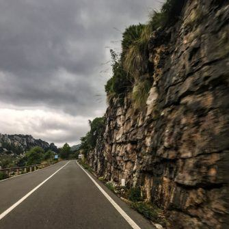 View of rocky cliffs by side of road on route of Mallorca 312