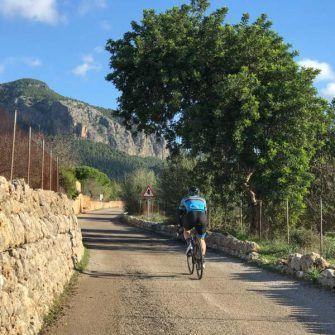 Cyclist riding along a lane near Alaro on Mallorca 312 route
