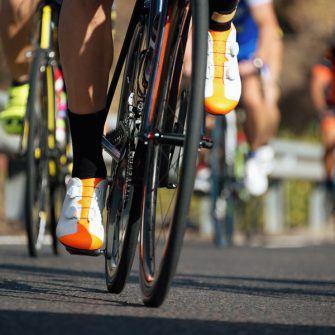 Cyclist pedalling in a granfondo event