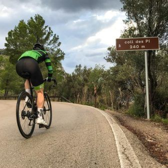 Cyclist climbing col on the Mallorca 312 route