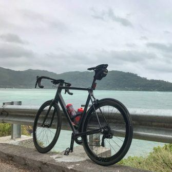 Bike in front of Anse Boileau beach