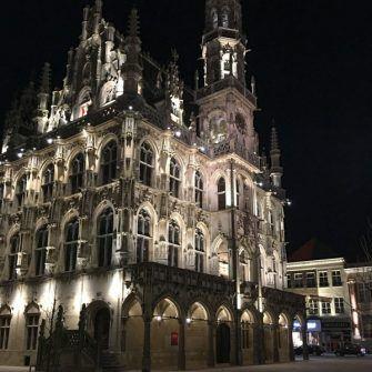 Oudenaarde town hall lit up at night, Belgium