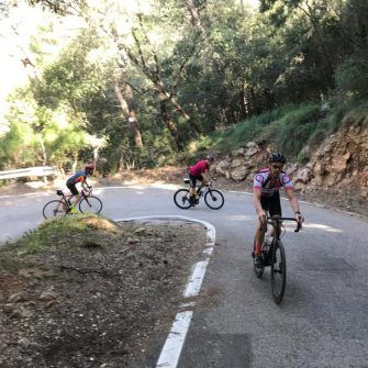 cyclists climbing up hairpin on mallorca 312 route