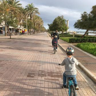 Children cycling along bike path in Palma