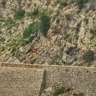 Massive rock walls support the Sa Calobra route