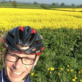 Monty from Sportive Cyclist in front of oilseed rape field in Derbyshire