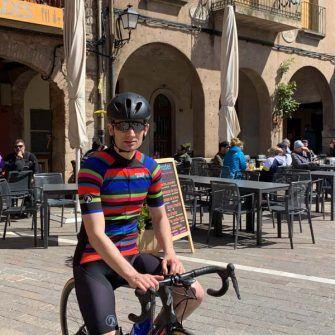 Cyclist outside cafes in Prades, Costa Daurada