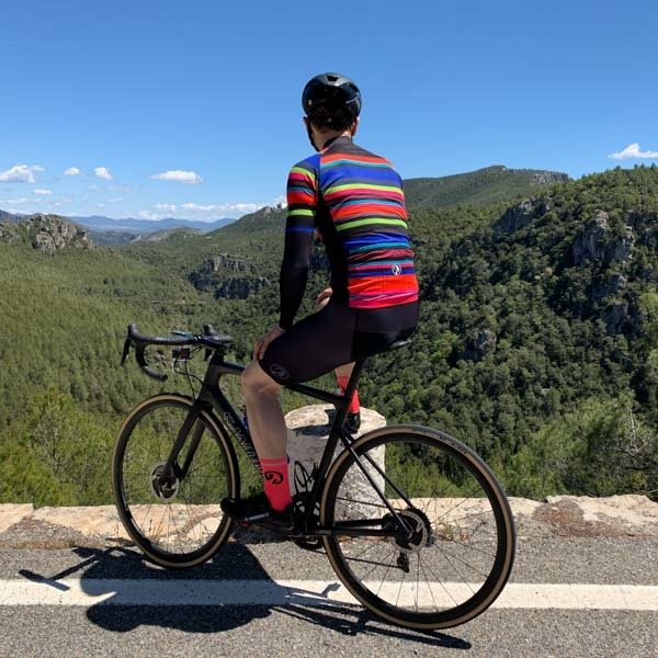 Cyclist admiring view in Prades mountains, Costa Daurada