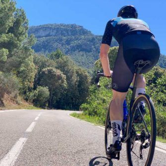 Cyclist heading into the Costa Daurada cycling hills