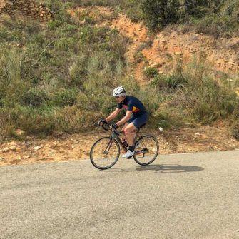 Cyclist climbing Puerto de la Virgen climb, Almeria