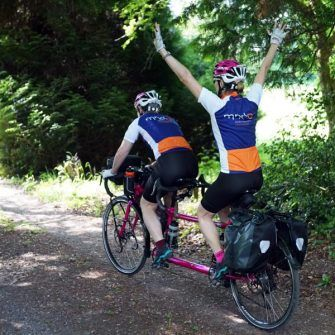 Cat and Raz in cycling kit raising money for Association of Motor Neurone Disease