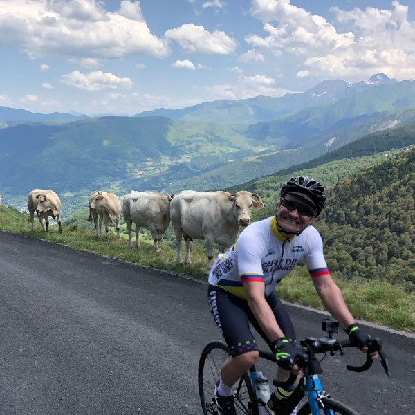 Cyclist on mountain stage of Tour de France route challenge ride