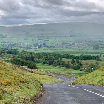 View down to Hawes from the Buttertubs Pass