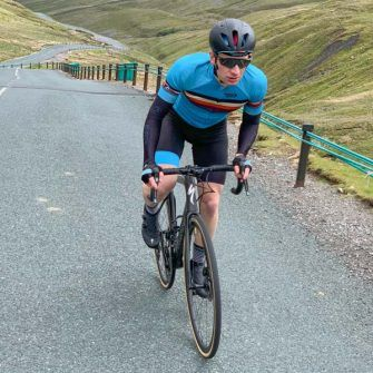 Cyclist out of the saddle on Buttertubs Pass, Yorkshire Dales