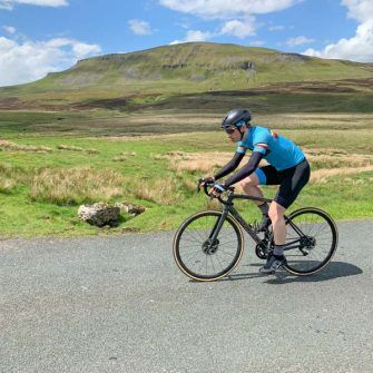 Cyclist with view to Pen-y-ghent