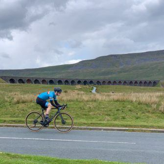 Cyclist with Ribblehead Viaduct behind