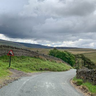 Warning sign and steep descent to Keld, Yorkshire Dales