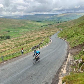 Cyclist on Fleet Moss climb