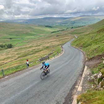 Cyclist on Fleet Moss climb