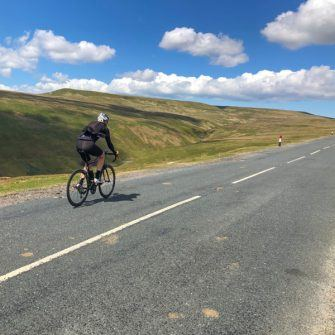 Cyclist on Greets Moss, Yorkshire Dales