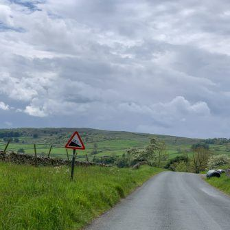 Descent to Settle on a steep road