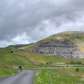 Cycling past the quarry near Helwith Bridge