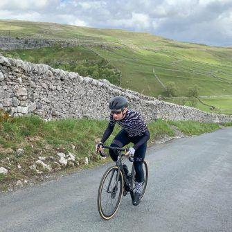 Climb up Malham Cove road by bike