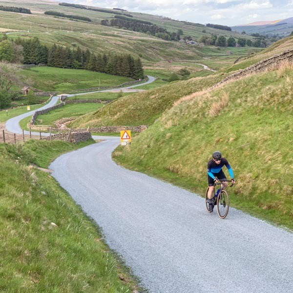 Cyclist cycling up Park Rash from Coverdale
